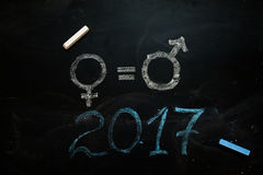 Gender symbols or signs for the male and female sex drawn on a blackboard Royalty Free Stock Photos