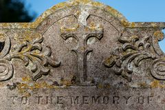 Genealogy and ancestry. Old graveyard headstone `to the memory of. Genealogy and ancestry. Old religious graveyard headstone to the memory of ancient ancestor stock photography