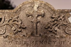 Genealogy and ancestry. Old graveyard headstone `to the memory o. Genealogy and ancestry. Old religious graveyard headstone to the memory of ancient ancient stock photo