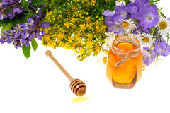 Geneeskrachtige kruiden en honing in volksgeneeskunde stock afbeeldingen