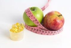 Geneeskunde en appel stock afbeeldingen