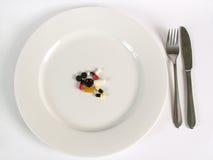 Geneeskunde voor diner Stock Afbeeldingen