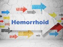 Geneeskundeconcept: pijl met Hemorrhoid op de achtergrond van de grungemuur Royalty-vrije Stock Foto