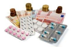 Geneesmiddelen en geld Stock Afbeeldingen