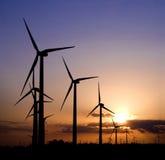 Generadores de viento en la puesta del sol Imagen de archivo libre de regalías