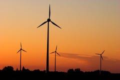 Generadores de viento en salida del sol Fotografía de archivo