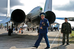 General Air Forces of Ukraine near the military aircraft. Colonel General of the Air Force of Ukraine passes near the military aircraft SU-27. Behind him is the Royalty Free Stock Photo