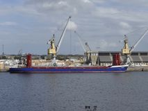 General cargo ship docked in the port. Stock Image