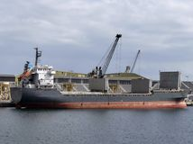 General cargo ship docked in the Port of St Malo. Royalty Free Stock Photography