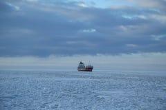 General cargo ship Eemsborg in frozen Baltic Sea near Kemi, Finland Royalty Free Stock Photos