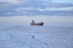 General cargo ship Eemsborg in frozen Baltic Sea near Kemi, Finland Stock Images