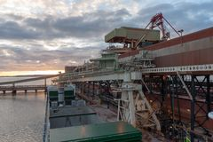 General cargo ship at grain terminal before loading operations. View from ships navigational bridge on deck. Holds are opened and ready for loading royalty free stock photography