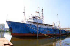 General cargo ship mooring at port wait cargo Royalty Free Stock Images