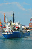 General cargo ship and port crane Stock Images
