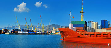 General cargo ship in the port waiting for containers in Genova, Italy . Stock Images