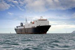 General cargo ship. Sailing close to the coast Royalty Free Stock Photos