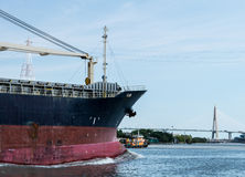General cargo ship. Cargo ships are leaving from the river to the sea Royalty Free Stock Photography