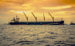 General cargo ship on sunset. Stock Photo