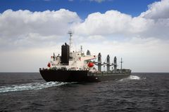 General cargo vessel. Sailing in open waters Stock Photos