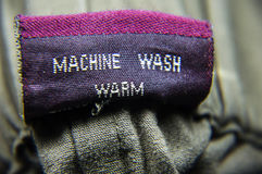 General Clothing Washing Instructions. Follow the instructions for washing the clothing items. Machine specifications for general wardrobe items stock photos