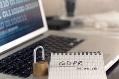 General Data Protection Regulation GDPR concept - new law in 201. 8 - checklist, notepad on keyboard wth padlock, binary data on screen Royalty Free Stock Image