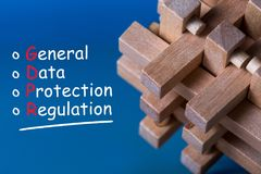 General Data Protection Regulation GDPR - Text on blue background with wooden brain teaser. Data Protection Concept. Royalty Free Stock Photo