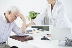 General doctor examining weak outpatient. At the health care center Royalty Free Stock Photos