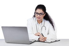 General doctor working on table Royalty Free Stock Photo