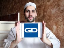 General Dynamics Corporation logo. Logo of General Dynamics Corporation on samsung tablet holded by arab muslim man. General Dynamics Corporation is an American Stock Images