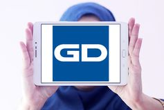 General Dynamics Corporation logo. Logo of General Dynamics Corporation on samsung tablet holded by arab muslim woman. General Dynamics Corporation is an Stock Photos
