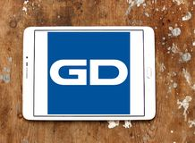 General Dynamics Corporation logo. Logo of General Dynamics Corporation on samsung tablet on wooden background. General Dynamics Corporation is an American Royalty Free Stock Photo