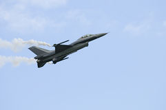General Dynamics F16. F16 passing by slowly with smoke pods Stock Images
