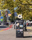 General Guisan quay in Zurich, Switzerland. Zurich, Switzerland - 7 October, 2017: advertising pillar with playbill of the Zurich Film Festival, people and royalty free stock photography