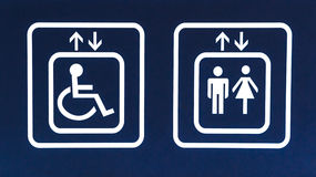 General and Handicap Accessible Elevator Sign, Closeup. White Elevator Sign on Blue Background, General and Handicap Accessible Elevator, Closeup Stock Images