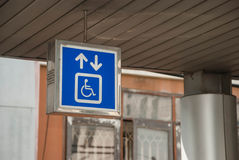 General and Handicap Accessible Elevator Sign, Closeup. White Elevator Sign on Blue Background, General and Handicap Accessible Elevator, Closeup Stock Photos