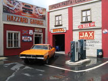 General Lee. The well known orange Dodge Charger driven by Bo and Luke in the series Dukes of Hazard at a gas station set built in the Movieland Studios park Stock Photo