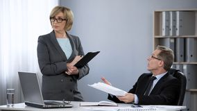 General manager criticizing female employee, stressful work in company office. Stock photo royalty free stock image