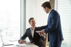 Boss giving money premium to happy employee