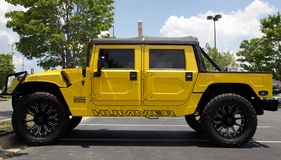 Hummer Sport Utility Vehicle Yellow Stock Photo