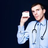 General Practitioner Doctor Holding Business Card Royalty Free Stock Photo