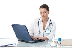 General practitioner typing on computer Royalty Free Stock Image