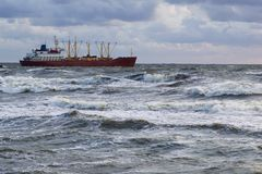 General purpose vessel. General purpose carrier vessel in the stormy sea royalty free stock photos
