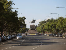 General Sarmiento Avenue in Buenos Aires. BUENOS AIRES – MARCH 30: General Sarmiento Avenue in a sunny day on March 30, 2013 in Buenos Aires. The monument at Royalty Free Stock Photography