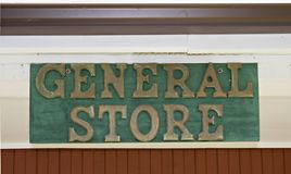 General Store. Sign above door of the General Store.  Located in a public park as part of a restoration project Stock Photos