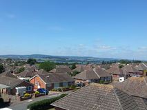 General UK town high level view. General UK town  high level view, with a clear blue sky day.  Showing tiled roofed houses, either terraced or semi detached Royalty Free Stock Image