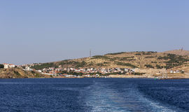General View of Bozcaada. General view from the city of Tenedos, Bozcaada with its historical castle and port as seen from sea stock photos