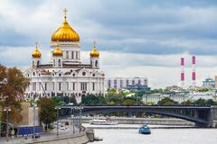 General view on a Cathedral of Christ the Savior and Bolshoy Kamenny Bridge editorial stock photo