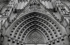 General view on the cathedral´s main arcade. Shot in black and white detail on the sculpture on the facade of this historic building representing some Stock Photography