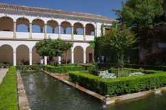 General view of The Generalife courtyard, with its famous fountain and garden. Alhambra de Granada complex, Spain stock images