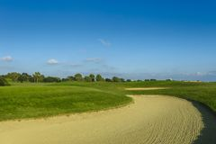 General view of a green golf course on a bright sunny day. Idyllic summer landscape. Sport, relax, recreation and Royalty Free Stock Photos